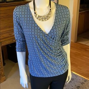 Liz Claiborne size small fits like a medium!
